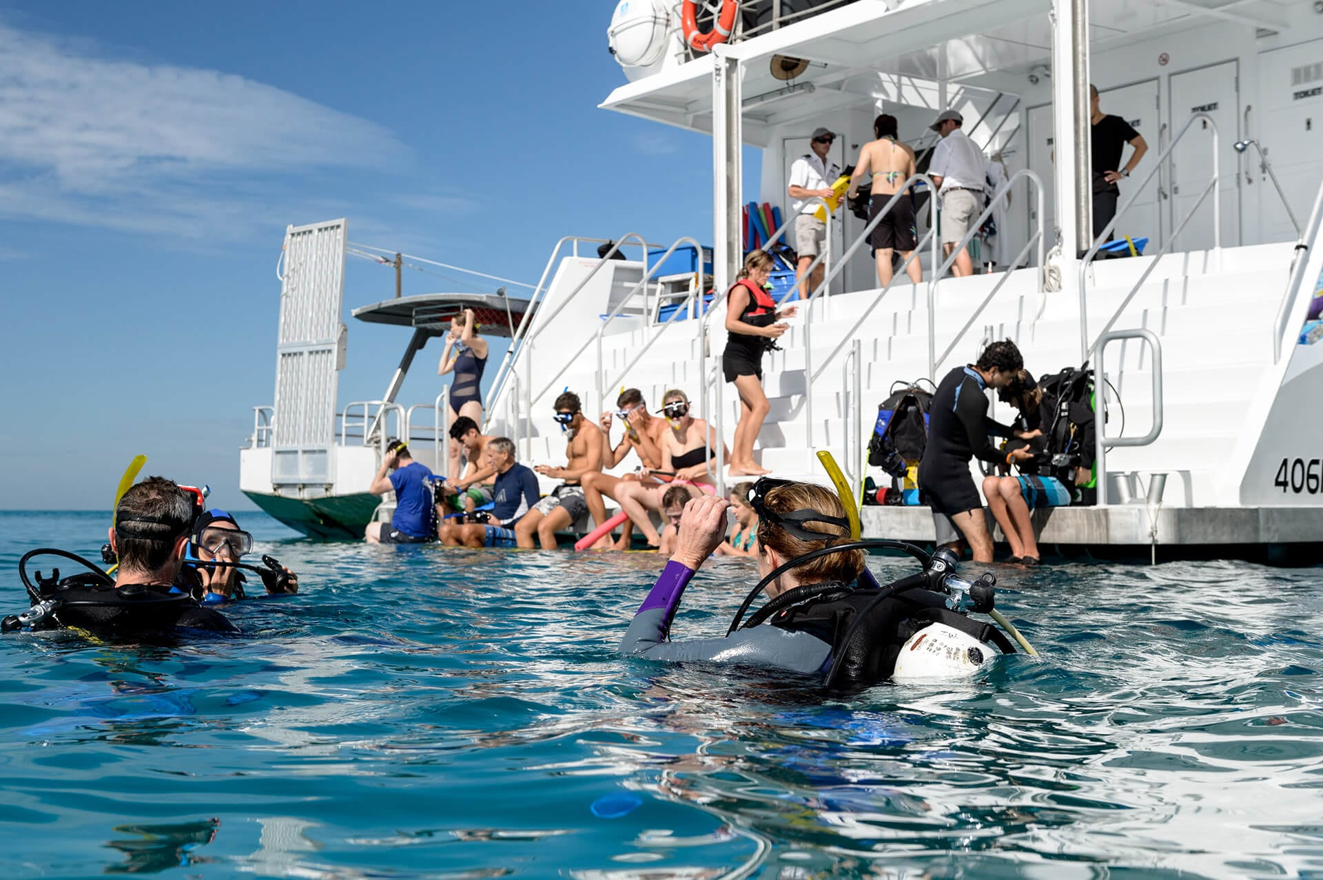 people snorkelling back of boat